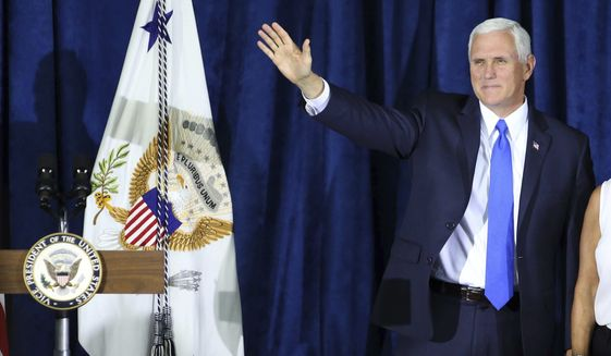 Vice president Mike Pence takes the stage to deliver remarks before assisting volunteers working on the relief effort for the Puerto Rico victims of Hurricane Maria, at the Iglesia de Dios church in Kissimmee, Fla., Thursday, Thursday, Oct. 5, 2017. (Joe Burbank /Orlando Sentinel via AP)
