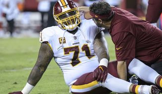 Washington Redskins offensive tackle Trent Williams (71) is treated during the first half of an NFL football game in Kansas City, Mo., Monday, October 2, 2017. (AP Photo/Reed Hoffmann)