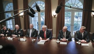 President Donald Trump, center, talks during a briefing with senior military leaders in the Cabinet Room of the White House in Washington, Thursday, Oct. 5, 2017, with Gen. Joseph L. Votel, commander of U.S. Central Command, National Security Adviser H.R. McMaster, Defense Secretary Jim Mattis, White House Chief of Staff John Kelly, and Deputy Secretary of Defense Patrick Shanahan. (AP Photo/Pablo Martinez Monsivais)