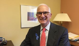 John Gordon is photographed at his office in St. Paul, Minn., on Wednesday, Oct. 4, 2017.  Gordon was named executive director of the American Civil Liberties Union of Minnesota on Thursday. He told The Associated Press that defending the Constitution is more important than ever now, when cruelty, homophobia, racism and violence permeate people's lives.  (AP Photo/Amy Forliti)