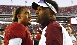 FILE - In this Oct. 22, 2016, file photo, Alabama quarterback Jalen Hurts walks away after hugging Texas A&M head coach Kevin Sumlin, after Alabama defeated Texas A&M, 33-14, in an NCAA college football game in Tuscaloosa, Ala. Hurts is heading home with the nation's top-ranked team in tow and a track record that comes as no surprise to Texas A&M coach Sumlin. (AP Photo/Brynn Anderson, File)