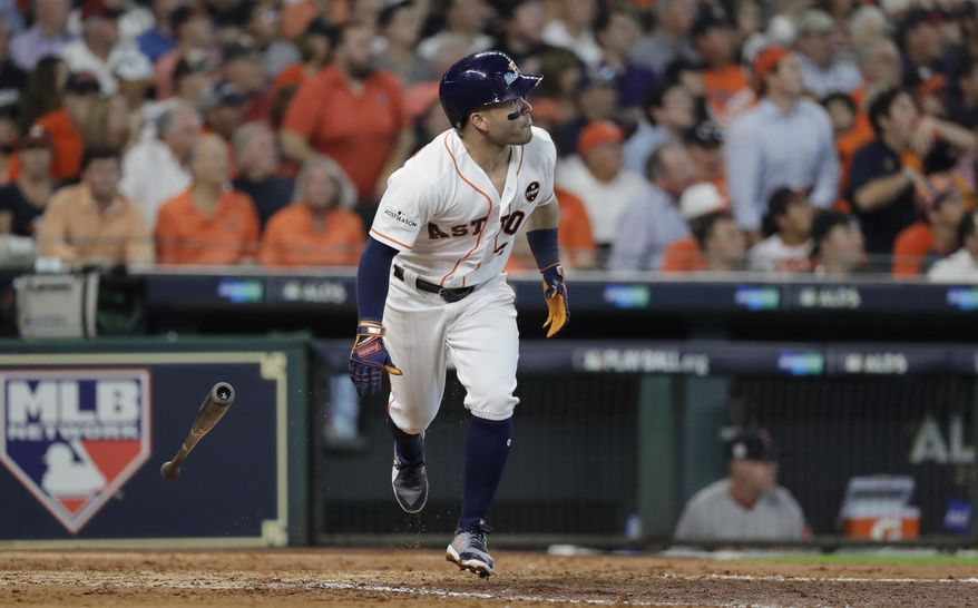 Houston Astros' Jose Altuve watches his solo home run off Boston Red Sox starting pitcher Chris Sale during the fifth inning in Game 1 of a baseball American League Division Series, Thursday, Oct. 5, 2017, in Houston. (AP Photo/David J. Phillip)