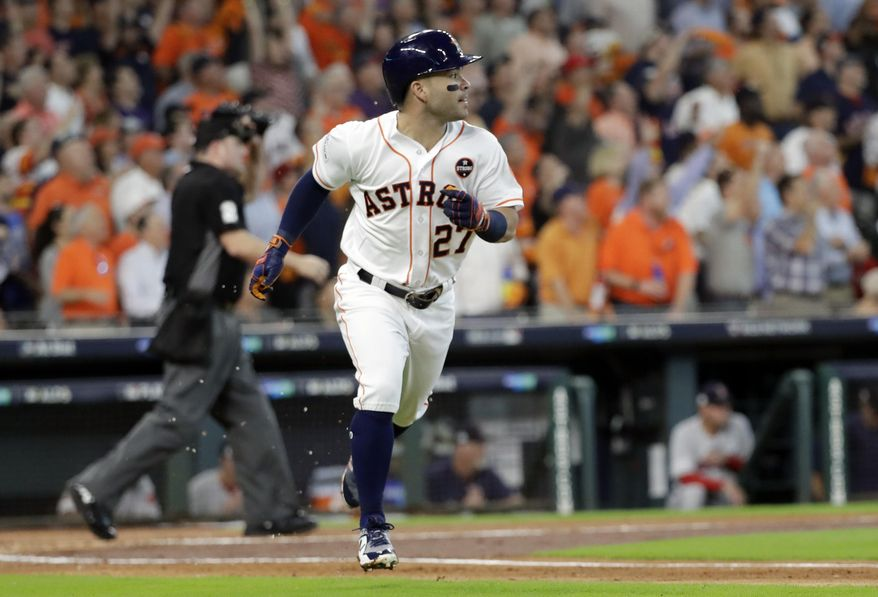 Houston Astros' Jose Altuve (27) watches his home run clear the fence during the first inning in Game 1 of baseball's American League Division Series against the Boston Red Sox, Thursday, Oct. 5, 2017, in Houston. (AP Photo/David J. Phillip)
