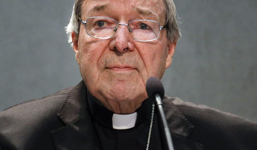 FILE - In this June 29, 2017 file photo, Cardinal George Pell meets the media, at the Vatican. Cardinal George Pell, the most senior Catholic official to face sex offense charges, was jeered by protesters as he made a court appearance on Friday, Oct. 6, 2017 in his native Australia. (AP Photo/Gregorio Borgia, File)