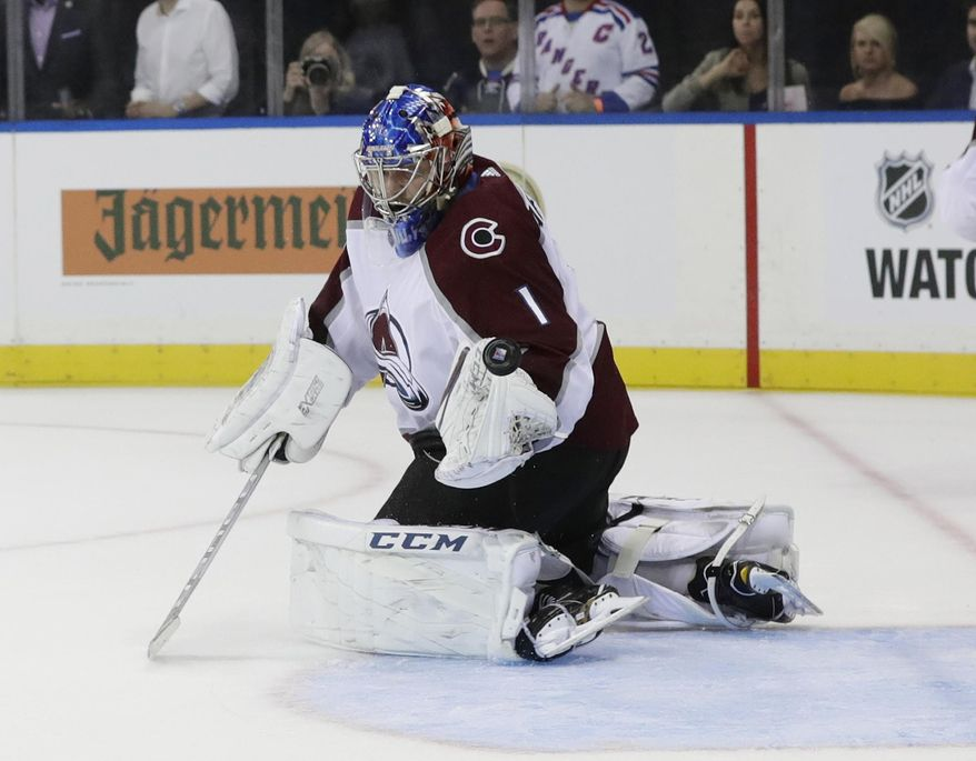 Colorado Avalanche goalie Semyon Varlamov (1) stops a shot on the goal during the second period of an NHL hockey game against the New York Rangers Thursday, Oct. 5, 2017, in New York. (AP Photo/Frank Franklin II)