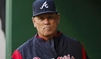 FILE - In this April 8, 2017, file photo, Atlanta Braves manager Brian Snitker walks in the dugout before a baseball game against the Pittsburgh Pirates in Pittsburgh. The Atlanta Braves have exercised their option on manager Brian Snitker for the 2018 season.  The decision to retain Snitker came after the Braves finished third in the NL East at 72-90, a small improvement from 68 wins in 2016. (AP Photo/Gene J. Puskar, File)