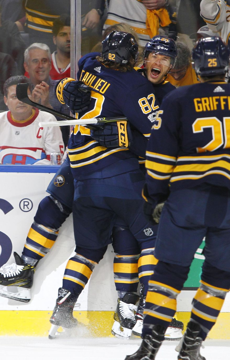 Buffalo Sabres Nathan Beaulieu (82) celebrates a goal with Jason Pominville (29) during the first period of an NHL hockey game against the Montreal Canadiens, Thursday Oct. 5, 2017, in Buffalo, N.Y. (AP Photo/Jeffrey T. Barnes)
