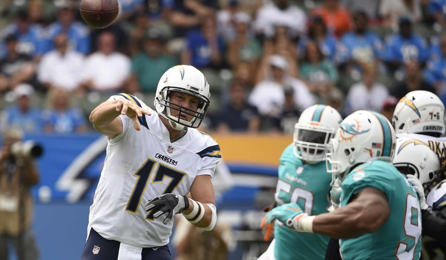 FILE - In this Sept. 17, 2017, file photo, Los Angeles Chargers quarterback Philip Rivers (17) throws a pass against the Miami Dolphins during an NFL football game in Carson, Calif. The Chargers and the New York Giants, both 0-4, play this week. (AP Photo/Denis Poroy, File)