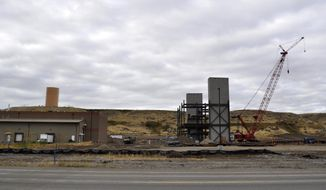 This Sept. 24, 2017 photo, shows construction on a new production facility for Cody Laboratories which will adjoin the company's warehouse in Cody, Wyo. The State Loan and Investment Board has approved loaning an additional $12 million to a pharmaceutical manufacturer in northern Wyoming. The board made up of Gov. Matt Mead and the four other statewide elected officials unanimously approved the new loan for Cody Laboratories on Thursday, Oct. 5, 2017. (Tessa Baker/The Powell Tribune via AP)