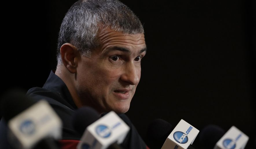 FILE - In this March 30, 2017, file photo, South Carolina head coach Frank Martin answers questions after a practice session for their NCAA Final Four tournament college basketball semifinal game, in Glendale, Ariz. Frank Martin would love to spend his time discussing how South Carolina would build on its Final Four surprise run from a year ago. Instead, he'll talk about the federal probe into college basketball which included his former asisstant Lamont Evans, who worked at South Carolina before moving to Oklahoma State. (AP Photo/David J. Phillip, File)