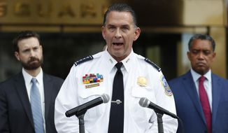 District of Columbia Police Chief Peter Newsham, joined by District of Columbia Council member Charles Allen, left and District of Columbia Attorney General Karl Racine, speaks during a news conference at One Judiciary Square in Washington, Thursday, Oct. 5, 2017. (AP Photo/Carolyn Kaster) ** FILE **