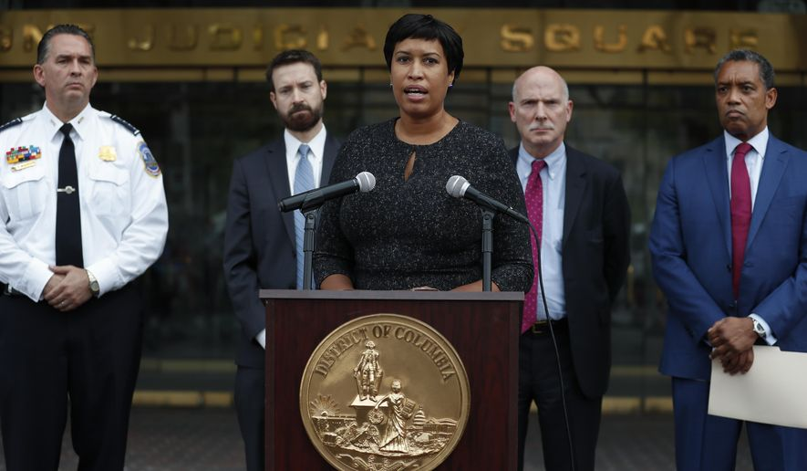 District of Columbia Mayor Muriel Bowser, joined by from left, District of Columbia Police Chief Peter Newsham, District of Columbia Council member Charles Allen, District of Columbia Council Chairman Phil Mendelson, and District of Columbia Attorney General Karl Racine, speaks at One Judiciary Square in Washington, Thursday, Oct. 5, 2017. District of Columbia officials say they won't appeal a court ruling against a strict city gun law, setting the stage for it to become easier for gun owners to get concealed carry permits in the city. City officials announced their decision not to take the case to the Supreme Court. (AP Photo/Carolyn Kaster)