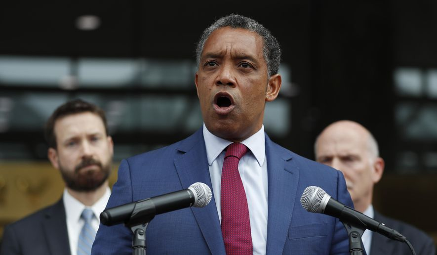 District of Columbia Attorney General Karl Racine, joined by from left, District of Columbia Council member Charles Allen and District of Columbia Council Chairman Phil Mendelson, speaks at One Judiciary Square in Washington, Thursday, Oct. 5, 2017. District of Columbia officials say they won't appeal a court ruling against a strict city gun law, setting the stage for it to become easier for gun owners to get concealed carry permits in the city. City officials announced their decision not to take the case to the Supreme Court. (AP Photo/Carolyn Kaster) **FILE**