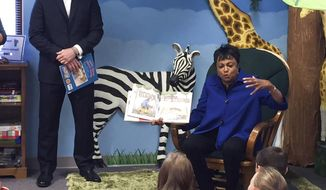 "In this Sept. 9, 2017 photo, Carla Hayden, the Librarian of Congeress, reads the book  ""Thomas Jefferson Builds a Library"" to children and adults during story time at the Rochester Public Library in Rochester, Ill. Hayden visited the librarys in Rochester and Springfield. and also the Central Illinois African American Museum in Springfield. (Tamara Browning/The State Journal-Register via AP)"