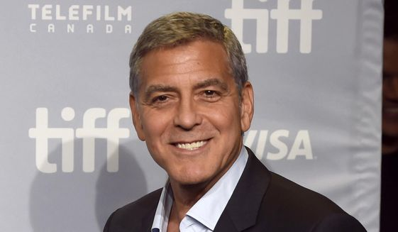 """In this Sept. 10, 2017, file photo, George Clooney attends a press conference for """"Suburbicon"""" at the Toronto International Film Festival in Toronto. (Photo by Chris Pizzello/Invision/AP, File)"""