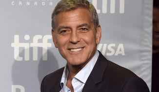 "In this Sept. 10, 2017, file photo, George Clooney attends a press conference for ""Suburbicon"" at the Toronto International Film Festival in Toronto. (Photo by Chris Pizzello/Invision/AP, File)"