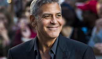 "FILE - In this Sept. 9, 2017 file photo, director and actor George Clooney arrives at a screening for ""Suburbicon"" during the Toronto International Film Festival in Toronto. Clooney will be the 46th recipient of the AFI Life Achievement Award. The American Film Institute announced Thursday that they will honor the actor-director at a gala tribute in June. (Nathan Denette/The Canadian Press via AP, File)"