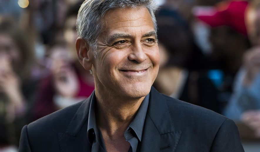 "In this Sept. 9, 2017 file photo, director and actor George Clooney arrives at a screening for ""Suburbicon"" during the Toronto International Film Festival in Toronto. (Nathan Denette/The Canadian Press via AP, File)"