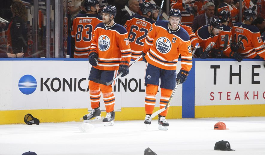 a9c29fc6472 Edmonton Oilers  Oscar Klefbom (77) and Connor McDavid (97) wait for hats  to be picked up after Connor McDavid scored a hat trick against the Calgary  Flames ...
