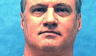This undated photo provided by the Florida Department of Law Enforcement, shows Michael Lambrix in custody. Lambrix is scheduled for execution Thursday, Oct. 5, 2017, for the 1983 killings of Clarence Moore and Aleisha Bryants near LaBelle, Fla. (Florida Department of Law Enforcement via AP)