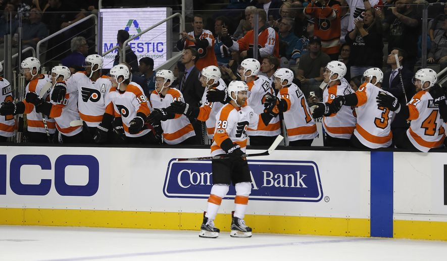 Philadelphia Flyers center Claude Giroux (28) is congratulated by teammates after scoring a goal against the San Jose Sharks during the first period of an NHL hockey game, Wednesday, Oct. 4, 2017, in San Jose, Calif. (AP Photo/Tony Avelar)