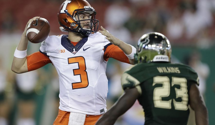 FILE - In this Sept. 15, 2017, file photo, Illinois quarterback Jeff George Jr. throws a pass as he is pressured by South Florida cornerback Mazzi Wilkins during the fourth quarter of an NCAA college football game in Tampa, Fla. With his team ranked last in the Big Ten in total offense and just 73 points through four games, coach Lovie Smith has made Jeff George Jr. the No. 1 quarterback nearly 30 years after his father ran the Illini offense on the way to becoming the top pick in the NFL draft. (AP Photo/Chris O'Meara, File)