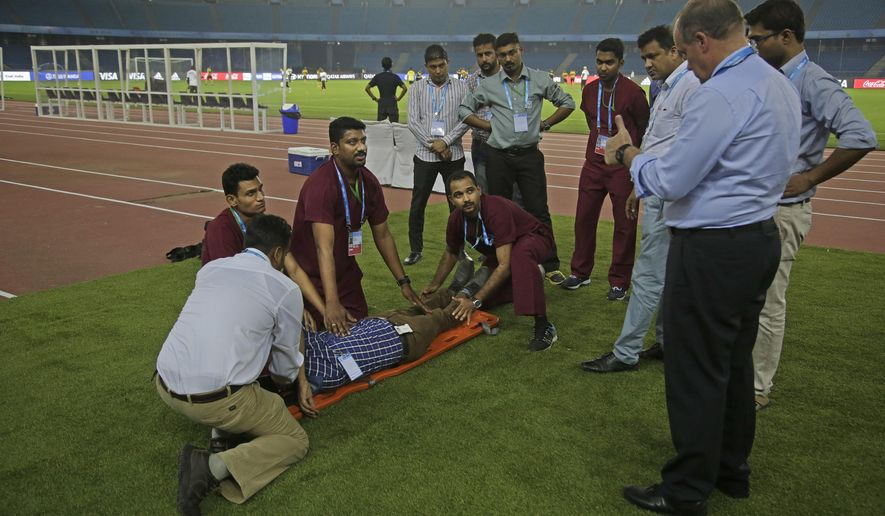 Paramedics undergo a mock drill to evacuate injured at Jawaharlal Nehru Stadium, one of the venues for the FIFA U-17 World Cup in New Delhi, India, Wednesday, Oct. 4, 2017. (AP Photo/Altaf Qadri)