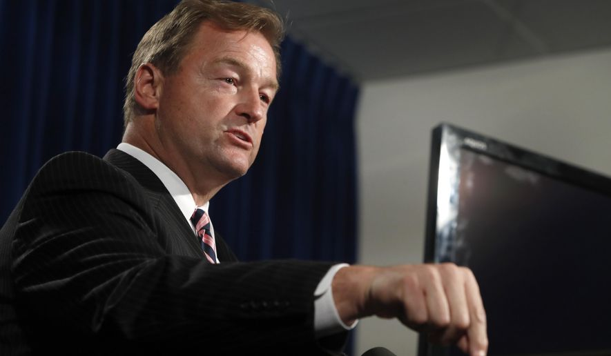 Sen. Dean Heller, R-Nev, speaks during a media briefing at Metro Police headquarters in Las Vegas Wednesday, Oct. 4, 2017. Investigators trying to figure out the Las Vegas gunman, Stephen Paddock's state of mind have so far been stymied by the secret life he appeared to lead before the attack on a country music concert on the Las Vegas Strip Sunday. (Steve Marcus/Las Vegas Sun via AP)