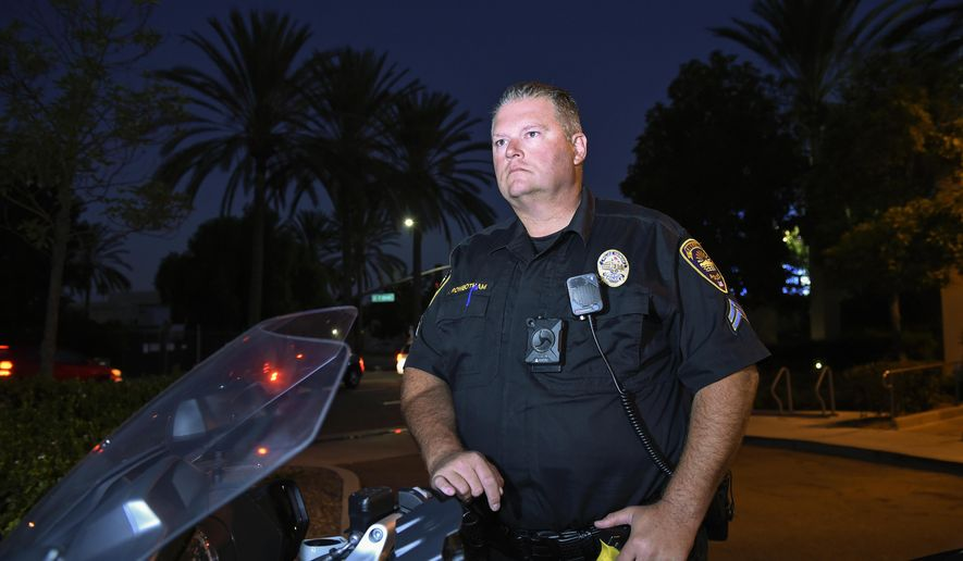 Chula Vista police officer Fred Rowbotham stands next to his motorcycle Thursday, Oct. 5, 2017, in Chula Vista, Calif. Rowbotham was injured at the Las Vegas shooting while attending the concert with his wife and friends. The Sunday night crowd of about 20,000 country music fans happened to include many off-duty police and firefighters like Rowbotham, who sprang into the role of first responders when tragedy struck and played an important role in saving lives. (AP Photo/Denis Poroy)