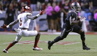 Louisville's Russ Yeast (6) chases North Carolina State's Jaylen Samuels (1) during the first half of an NCAA college football game in Raleigh, N.C., Thursday, Oct. 5, 2017. (AP Photo/Gerry Broome)