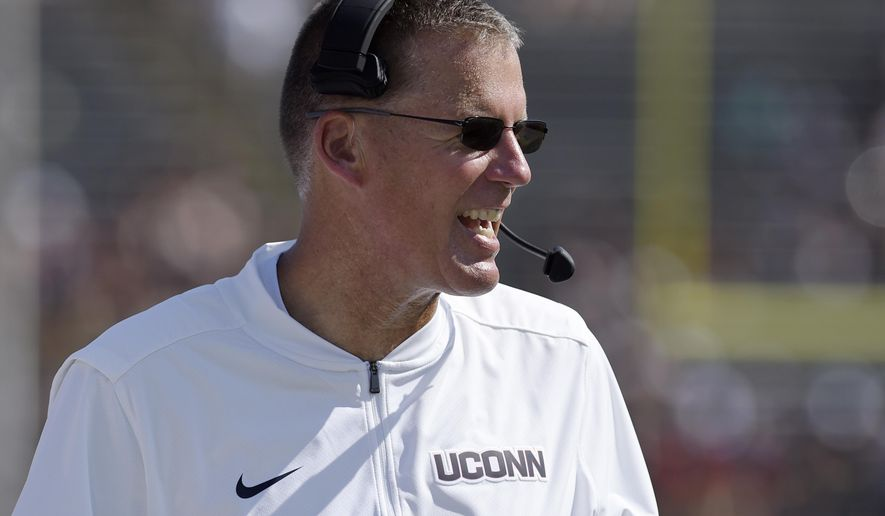 FILE - In this Sept. 24, 2017, file photo, UConn head coach Randy Edsall talks into his headset during the second half of an NCAA college football game against East Carolina, in East Hartford, Conn. Four games into his second stint as head coach at UConn, Randy Edsall says his biggest struggle hasn't been finding talent, but teaching players how to win.  (AP Photo/Jessica Hill, File)