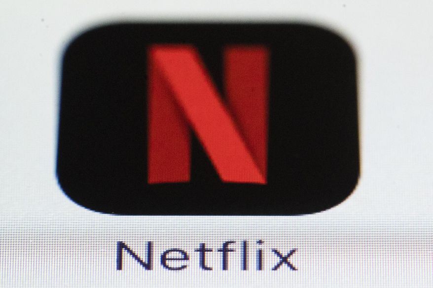 This Monday, July 17, 2017, photo shows the Netflix logo on an iPhone. On Thursday, Oct. 5, 2017, Netflix announced it is raising the price for its most popular U.S. video streaming plan by 10 percent in a move that may boost its profits, but slow the subscriber growth that drives its stock price. (AP Photo/Matt Rourke)
