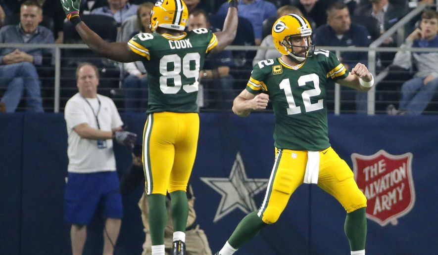 FILE - In this Jan. 15, 2017, file photo, Green Bay Packers' Aaron Rodgers (12) and Jared Cook (89) celebrate after a touchdown during the first half of an NFL divisional playoff football game against the Dallas Cowboys in Arlington, Texas. Packers-Cowboys has been one of the NFL's most entertaining and meaningful rivalries for decades. Whether it was the Ice Bowl or Rodgers' impromptu pass to Cook in the second half the playoff game, people (and players and coaches) remember these matchups. They'll be back at it on Sunday when Green Bay (3-1) visits Dallas (2-2). (AP Photo/Tony Gutierrez, File)