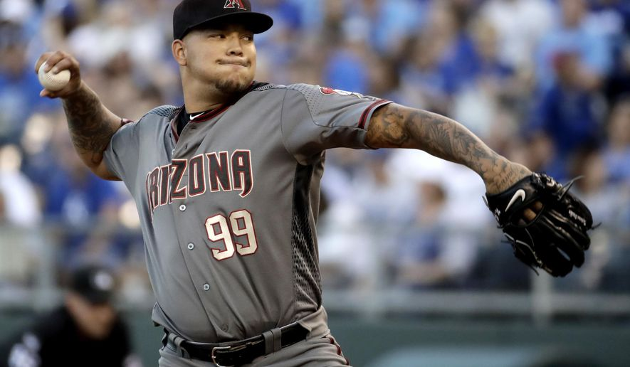FILE - In this Sept. 30, 2017, file photo, Arizona Diamondbacks starting pitcher Taijuan Walker throws during the first inning of a baseball game against the Kansas City Royals in Kansas City, Mo. Walker will start Arizona's NL Division Series opener against the Dodgers after the craziness of the Diamondbacks' wild-card game depleted their pitching staff. (AP Photo/Charlie Riedel, File)