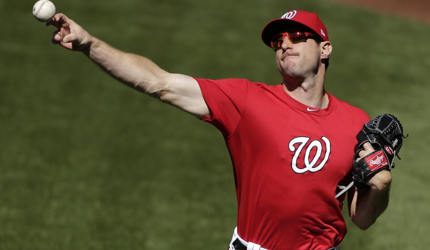 Washington Nationals' pitcher Max Scherzer throws during a baseball workout at Nationals Park, Wednesday, Oct. 4, 2017, in Washington. The Nationals host the Chicago Cubs in Game 1 of the National League Division Series on Friday. (AP Photo/Mark Tenally)