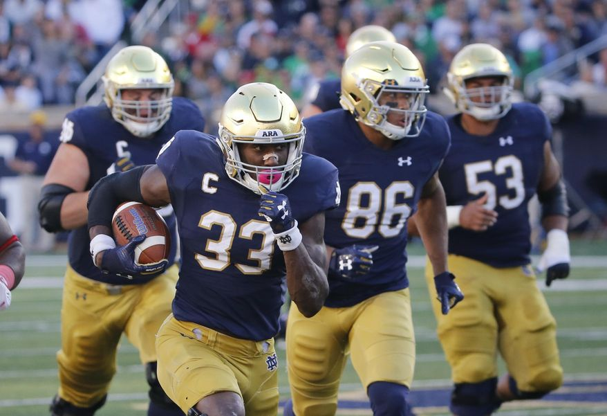 FILE - In this Sept. 30, 2017, file photo, Notre Dame running back Josh Adams heads for the end zone on a touchdown run during the first half of an NCAA college football game against Miami (Ohio) in South Bend, Ind. Adams is averaging 131.6 yards through five games to go with four touchdowns. The 6-2, 225-pound junior is determined to finish every run and get in the end zone, where the Irish are a perfect 22 for 22 in the red zone, one of 12 FBS teams to remain unblemished in that category. (AP Photo/Charles Rex Arbogast, File)