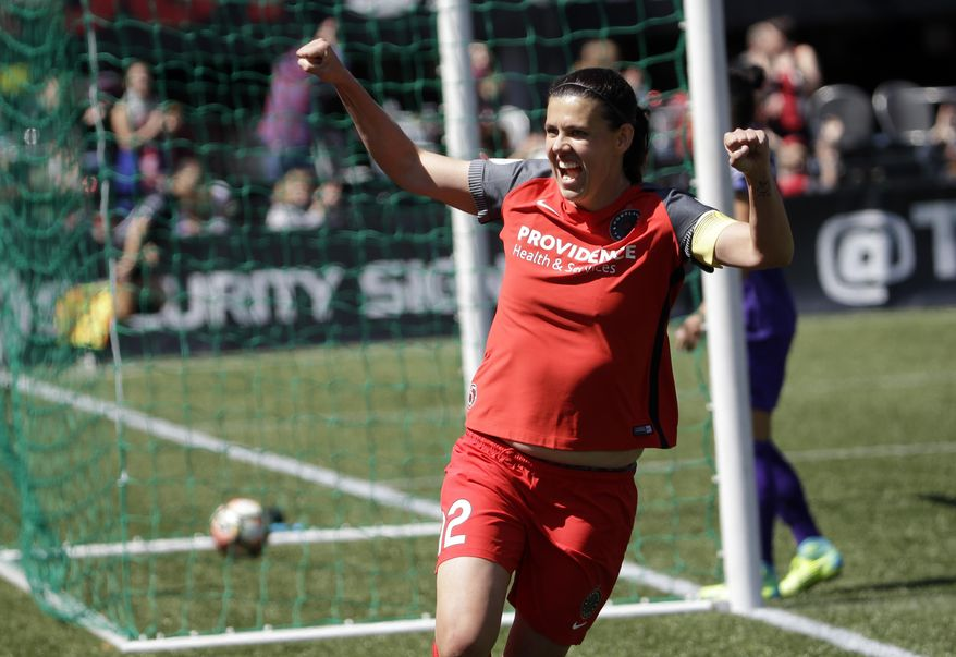 FILE - In this April 15, 2017, file photo, Portland Thorns forward Christine Sinclair celebrates scoring a goal during the second half of their NWSL soccer match against the Orlando Pride in Portland, Ore. The Thorns will host the third-place Pride in Portland on Saturday, Oct. 7, 2017, in their NWSL playoff semifinal game. (AP Photo/Don Ryan, File)
