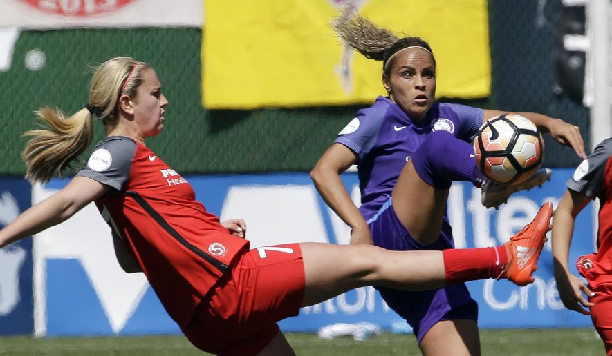 FILE - In this April 15, 2017, file  photo, Portland Thorns midfielder Lindsey Horan, left, and Orlando Pride defender Monica Hickmann Alves battle for the ball during the second half of their NWSL soccer match in Portland, Ore. The Thorns will host the third-place Pride in Portland on Saturday, Oct. 7, 2017, in their NWSL playoff semifinal game (AP Photo/Don Ryan, File) ** FILE **
