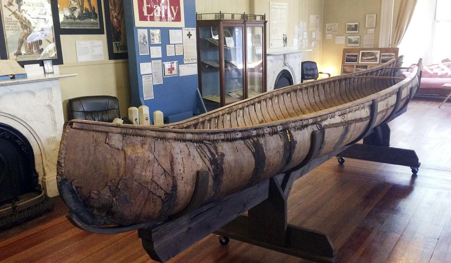 One of the oldest-known Native American birch-bark canoes, dated from the mid-1700's, is displayed at the Pejepscot Museum & Research Center in Brunswick, Maine, Thursday Oct. 5, 2017.   The society came into the possession of it in 1889. It had spent three decades in a barn before being placed in the museum.  (AP Photo/Patrick Whittle)