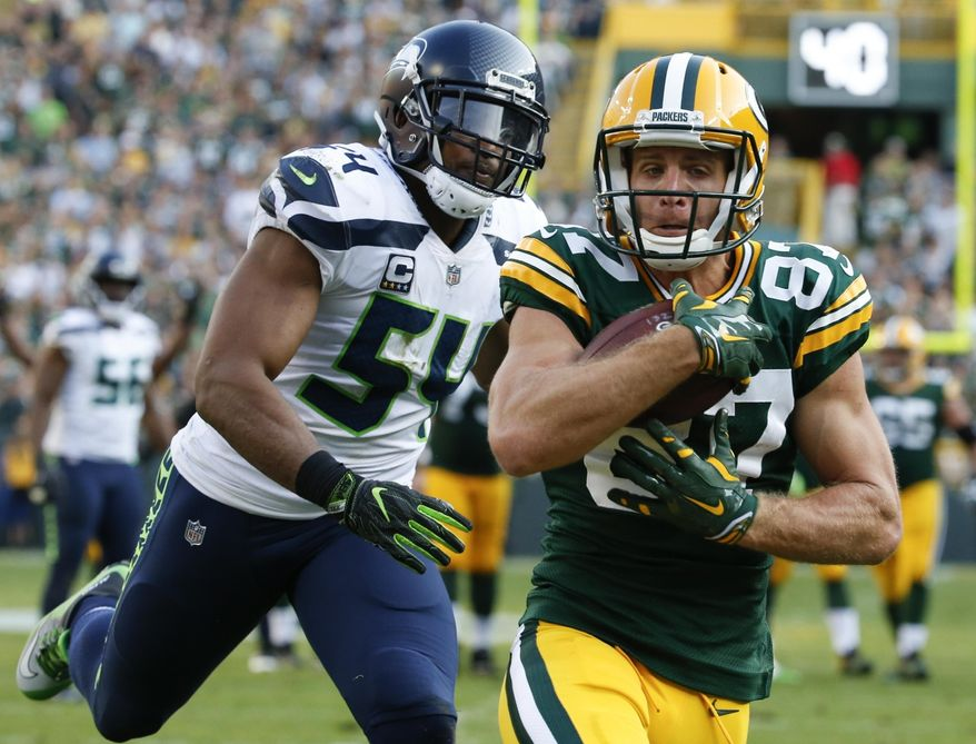 FILE - In this Sept. 10, 2017, file photo, Green Bay Packers' Jordy Nelson catches a touchdown pass in front of Seattle Seahawks' Bobby Wagner during the second half of an NFL football game, in Green Bay, Wis. Few receivers in the NFL are as productive inside the 20 as Green Bay Packers receiver Jordy Nelson. Four of his five touchdown catches this year already are in the red zone. (AP Photo/Mike Roemer, File)