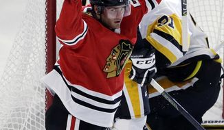 Chicago Blackhawks left wing Brandon Saad celebrates after scoring his first goal during the first period of an NHL hockey game against the Pittsburgh Penguins, Thursday, Oct. 5, 2017, in Chicago. (AP Photo/Nam Y. Huh)