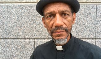 Darryl Gray, a pastor with deep roots in civil rights activism who serves as a mentor to the unofficial leaders of the so-called Frontline protest movement poses for a photo in St. Louis, Thursday, Oct. 5, 2017. Protests have been plentiful in St. Louis since the mid-September acquittal of Jason Stockley, a white former officer who fatally shot a black drug suspect, Anthony Lamar Smith, in 2011 while still on the city's police force. Young people have been thrust into activism driven by the belief that change won't happen until the entire region is confronted with the uncomfortable reality of racism. (AP Photo by Jim Salter)