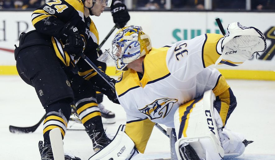 Boston Bruins' Jake DeBrusk (74) watches his shot for a goal on Nashville Predators' Alexei Emelin (35) during the second period of an NHL hockey game in Boston, Thursday, Oct. 5, 2017. (AP Photo/Michael Dwyer)