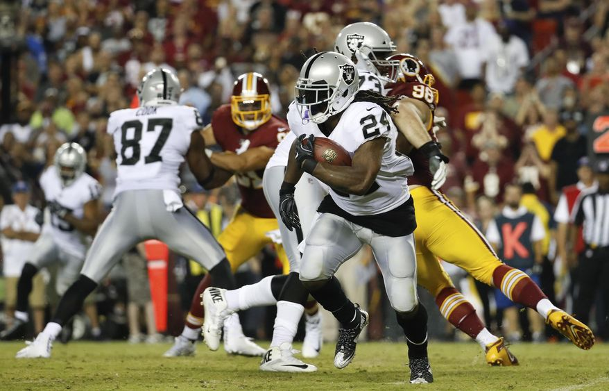FILE - In this Sunday, Sept. 24, 2017, file photo, Oakland Raiders running back Marshawn Lynch (24) carries the ball during the second half of an NFL football game against the Washington Redskins in Landover, Md. The Raiders running game hasn't gotten off the ground the past two games despite one of the NFL's top lines and Marshawn Lynch. (AP Photo/Alex Brandon, File)