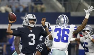 FILE - In this Saturday, Aug. 26, 2017 file photo, Oakland Raiders quarterback EJ Manuel (3) throws a pass as running back DeAndre Washington (33) helps against pressure from Dallas Cowboys safety Robert Blanton (36) during the first half of a preseason NFL football game in Arlington, Texas. The Raiders must reverse this slide without star quarterback Derek Carr, who broke a bone in his back in  Sunday, Oct. 1, 2017, 16-10 loss in Denver and is expected to miss between two and six weeks. That forces E.J. Manuel into the starting role and puts added pressure on the rest of the offense to get moving after struggling the past two weeks. (AP Photo/Ron Jenkins, File) **FILE**