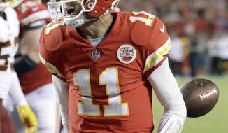 Kansas City Chiefs quarterback Alex Smith celebrates his touchdown during the second half of an NFL football game against the Washington Redskins in Kansas City, Mo., Monday, Oct. 2, 2017. (AP Photo/Charlie Riedel)