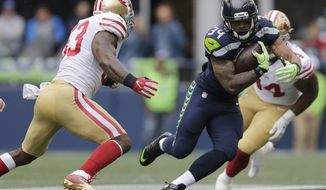 FILE - In this Sept. 17, 2017, file photo, Seattle Seahawks running back Thomas Rawls (34) rushes against the San Francisco 49ers during the first half of an NFL football game in Seattle. Rawls was suddenly the one left out of the Seahawks backfield a week ago. By the time Sunday rolls around in Los Angeles, Rawls could be Seattle's starting running back capping a roller coaster start to his season. (AP Photo/John Froschauer, File)