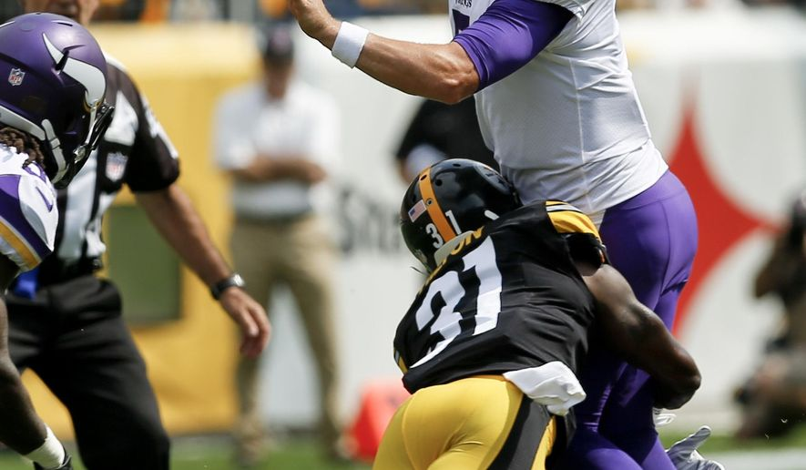 FILE - In this Sept. 17, 2017, file photo, Minnesota Vikings quarterback Case Keenum (7) gets a pass off as he is hit by Pittsburgh Steelers cornerback Mike Hilton (31) during the first half of an NFL football game in Pittsburgh. Hilton admits he's not the biggest guy. Yet the 5-foot-9, 184 pound Pittsburgh Steelers rookie cornerback has wasted little time making an impact.  (AP Photo/Keith Srakocic, File)