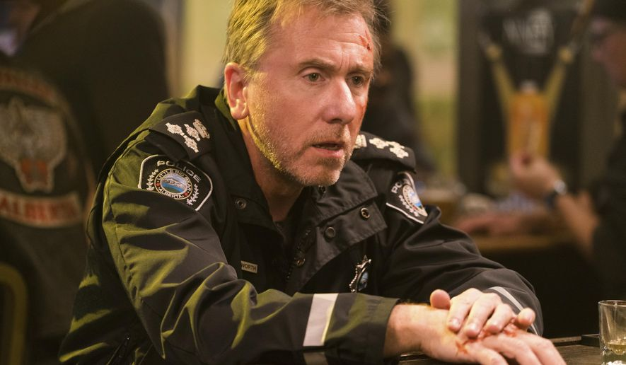 "This image released by Amazon shows Tim Roth as Jim Worth in a scene from the 10-episode mystery thriller, ""Tin Star."" Set in the Canadian Rockies, the series focuses on a former British detective who uproots his family and moves them to the tiny town of Little Big Bear for a presumably quieter life where he can serve as its parking-ticket-issuing police chief. (David Bukach/Amazon via AP)"