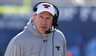 FILE - In this Jan. 7, 2017, file photo, Youngstown State head coach Bo Pelini walks along the sideline in the second half of the FCS championship NCAA college football game against James Madison, in Frisco, Texas. Pelini says a player convicted of rape as a teen has earned a second chance by staying disciplined, focused and out of trouble. Ma'lik Richmond will be allowed to remain on the team's active roster after settling a lawsuit Monday against the school, which told him he wouldn't be allowed to play this season after he made the team. Pelini told The Associated Press on Tuesday, Oct. 3, 2017, that he gave Richmond a chance after hearing him accept responsibility for his conviction. (AP Photo/Tony Gutierrez, File)